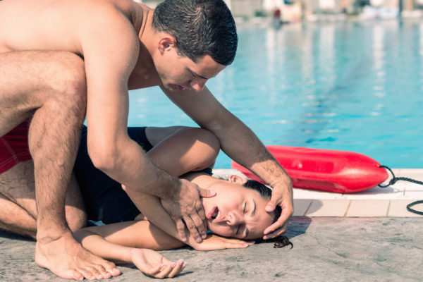 Lifeguard rescue procedure - positioning victim on her side, opening mouth